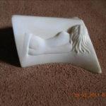 Sculpture de femme nue - la sieste